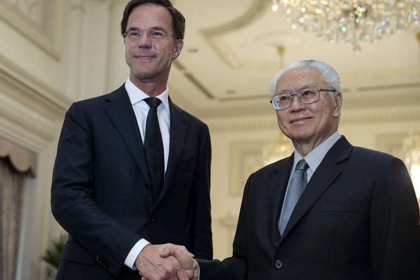 Dutch Prime Minister Mark Rutte (left) and President Tony Tan Keng Yam shake hands at the Istana Presidential Palace in Singapore on Nov 24, 2016.