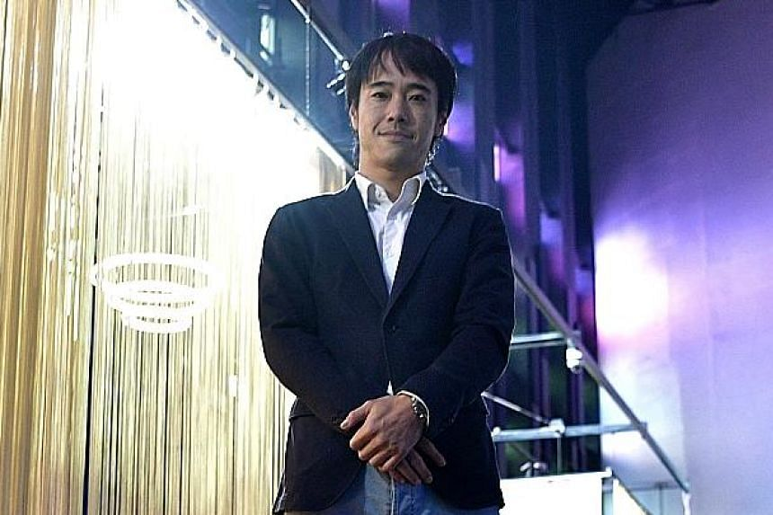 Mr Chan, Luxi Dance Club's general manager, finds St James Power Station particularly appealing because of its 20m-high ceiling, which provides enough space for light projection.