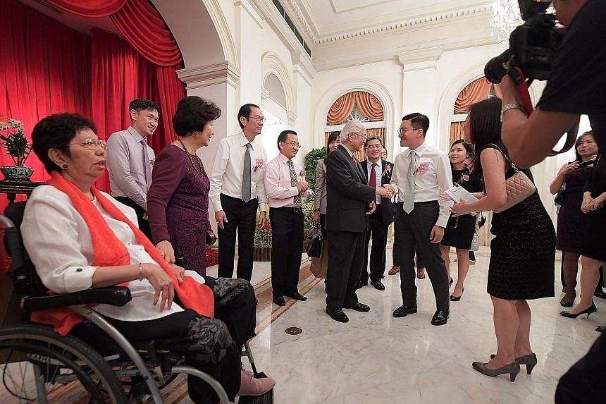 President Tan and Mrs Tan (in purple dress) with guests at the President's Challenge 2016 Appreciation Night at the Istana, held to thank sponsors, donors and volunteers for their contributions.