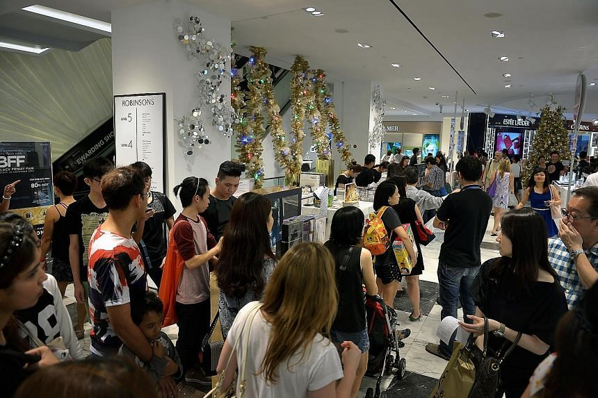 Shoppers at Robinsons The Heeren in Orchard Road on Black Friday in November 2014. The department store and furniture retailer Courts will offer promotions for Black Friday, a shopping frenzy which is a US tradition celebrated on the last Friday of N