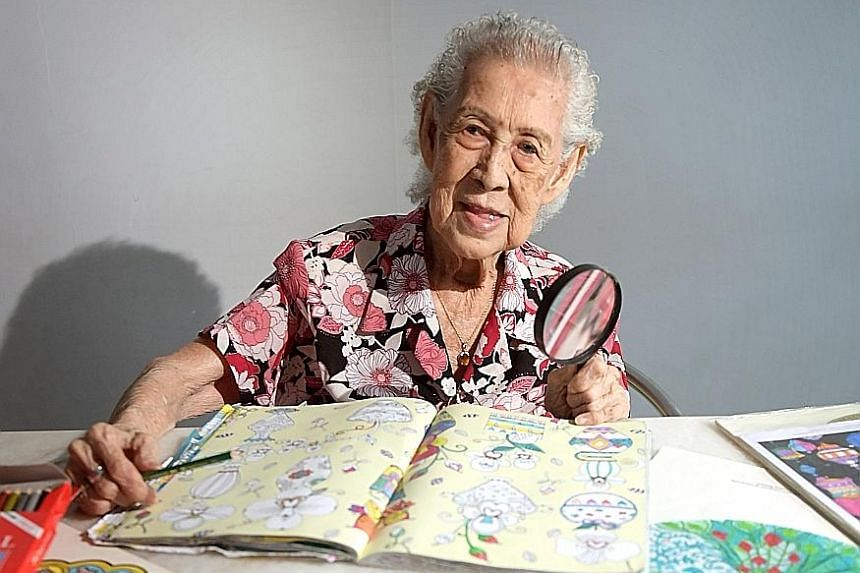 Madam Yeo derives simple joy from colouring intricate mandala designs.