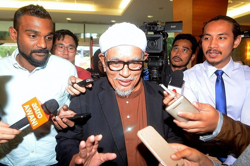The hudud Bill was proposed by Parti Islam SeMalaysia president Abdul Hadi Awang (above, wearing spectacles).