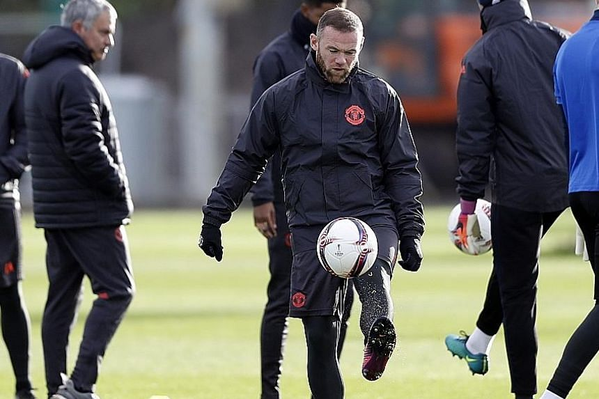 Manchester United's Wayne Rooney during a training session ahead of the Europa League clash with Feyenoord at Old Trafford today. The United captain will be hoping he will get to start the match, after coming off the bench to good effect against Arse