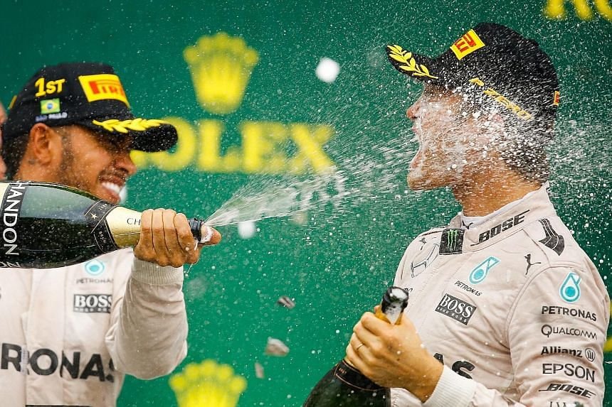 Lewis Hamilton (left) and world title leader Nico Rosberg. The Briton, who has won the world championship three times, will do his best at the Abu Dhabi GP on Sunday to prevent his Mercedes team-mate from joining Michael Schumacher and Sebastian Vett