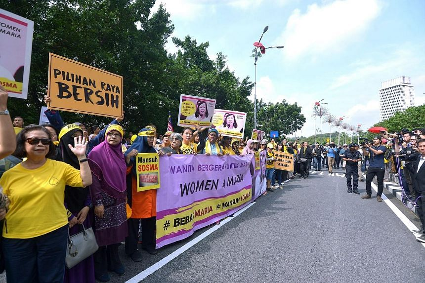 """The """"Women Walk for Maria"""" group gathering outside Parliament yesterday to deliver a memorandum to the government demanding the release of Ms Chin."""