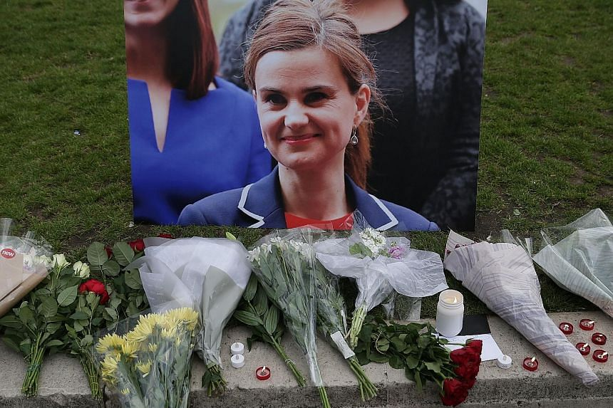 A weapon (top) shown to the jury during the trial. Mair (above) faces life in prison. Floral tributes and candles in front of a picture of slain Labour MP Jo Cox at a vigil in London on June 16, a week before the British referendum on membership in t