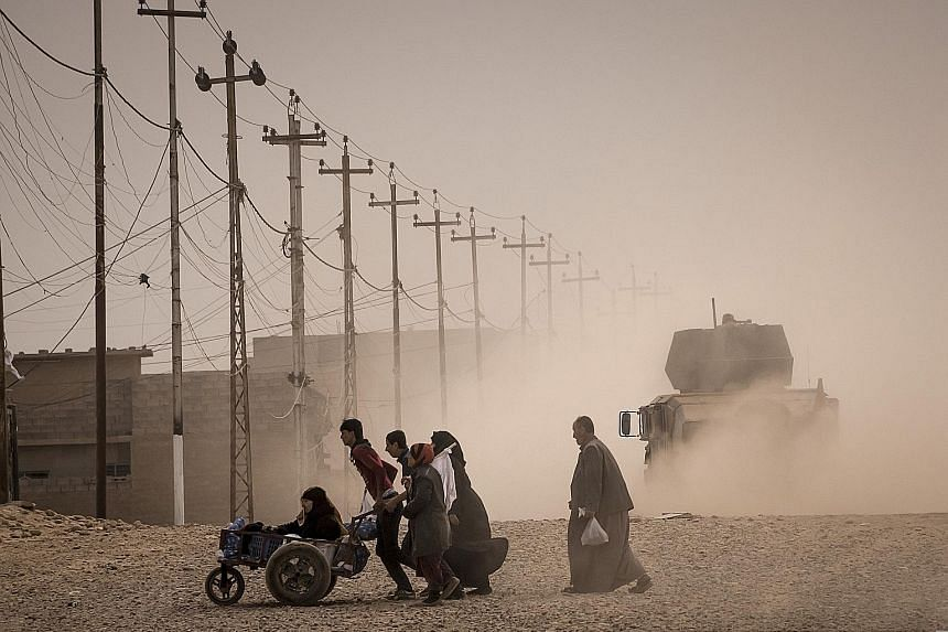 Iraqis fleeing Mosul as the battle to retake the city from ISIS turns into a gruelling fight. Almost 70,000 people have been displaced so far, roughly half of them children, says the UN. But there could be a million more people still in the city, Ira