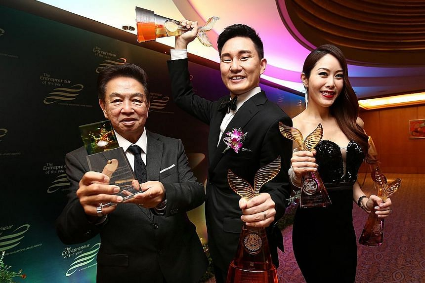 (From far left) Direct Funeral Services founder Roland Tay, executive director Darren Cheng and managing director Jenny Tay. Ms Tay and Mr Cheng were recognised at the Entrepreneur of the Year awards yesterday, taking home honours in the new entrepre