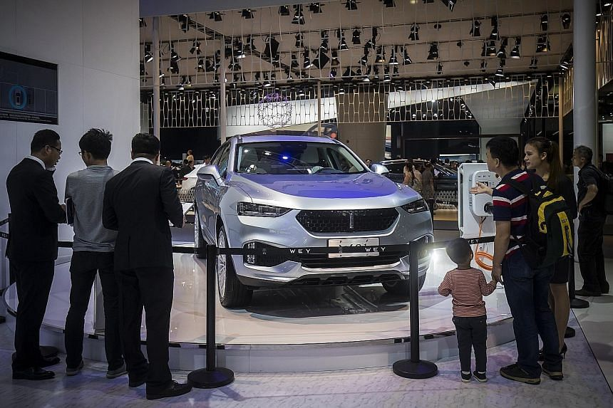 "A Wey sport utility vehicle, manufactured by Great Wall Motor, on display at the Guangzhou Auto Show last weekend. Great Wall chairman Wei Jianjun wants the Wey brand ""to carry the flag for Chinese luxury SUVs globally and to end the era of excessive"
