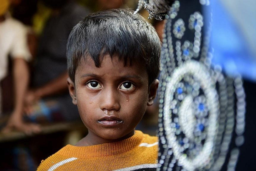 Noor Sahara, six, near a refugee camp in Teknaf, in Bangladesh, yesterday. Her mother is missing and she crossed over the border with her neighbour Roshida. A surge in violence in Myanmar has forced many Rohingya to seek refuge in neighbouring Bangla