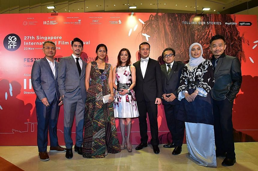 (From left) Alvin Wong, Iedil Putra, Prisia Nasution, Michelle Yeoh, Nicholas Saputra, Dain Iskandar Said, Nadiya Nisaa and Chew Kin-wah at the opening of the Singapore International Film Festival at Marina Bay Sands yesterday.