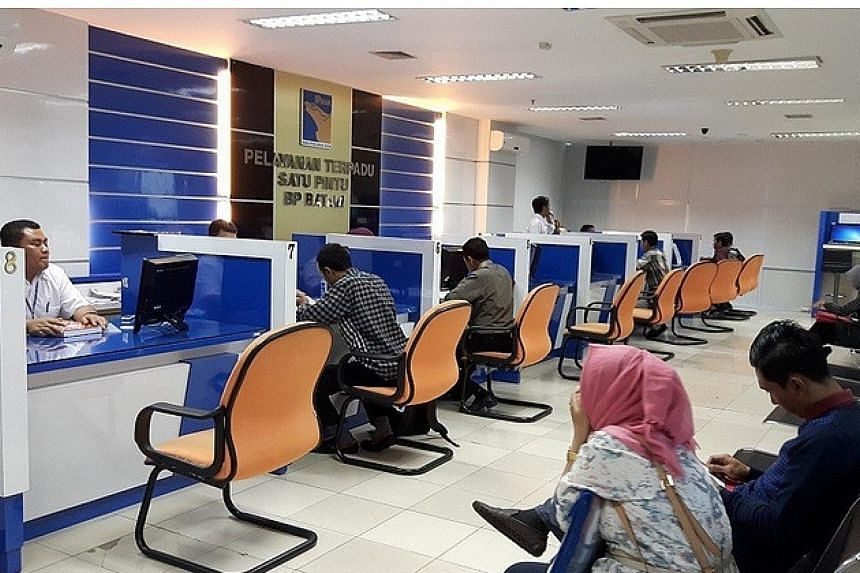 Business people apply for permits at the one-stop service agency of Batam. Business licence approvals for companies will now take only three hours, when previously they could take weeks to months.