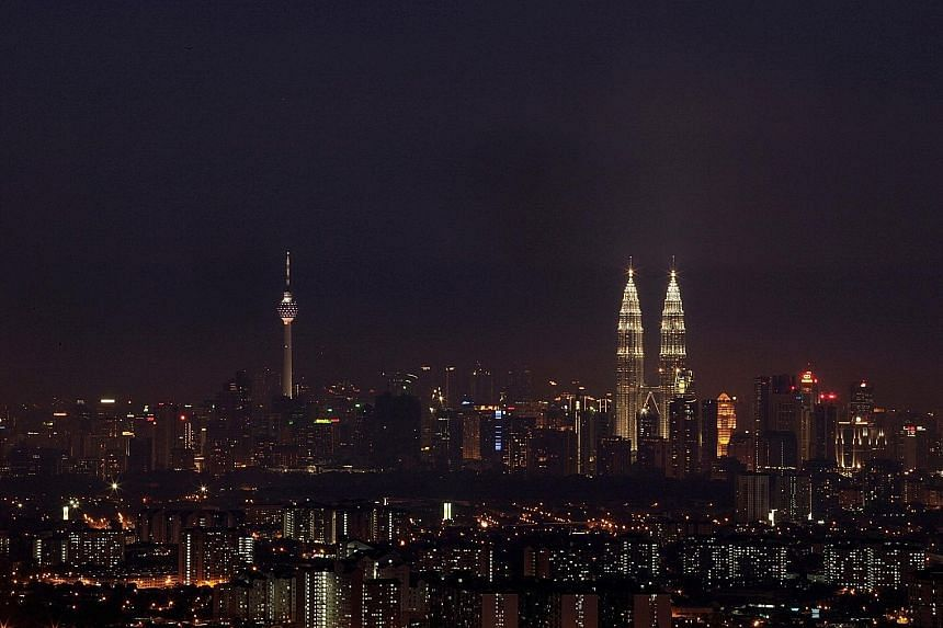 Night falls over the Malaysian capital Kuala Lumpur. Malaysia's economy is forecast to expand at a seven-year low of 4 per cent to 4.5 per cent in 2016.