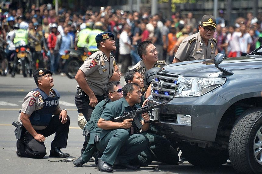 Indonesian police in Jakarta taking position behind a vehicle in pursuit of suspects during the Jan 14 terror attack, in which eight people, including the four perpetrators, died. The Islamic State in Iraq and Syria later claimed responsibility for t
