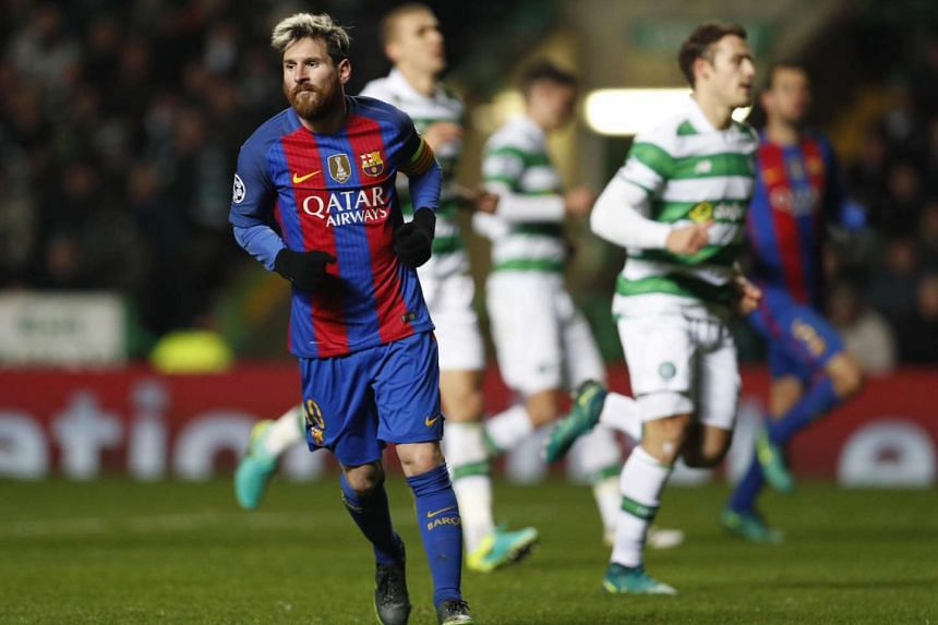 Barcelona's Lionel Messi celebrates scoring their second goal against Celtic.