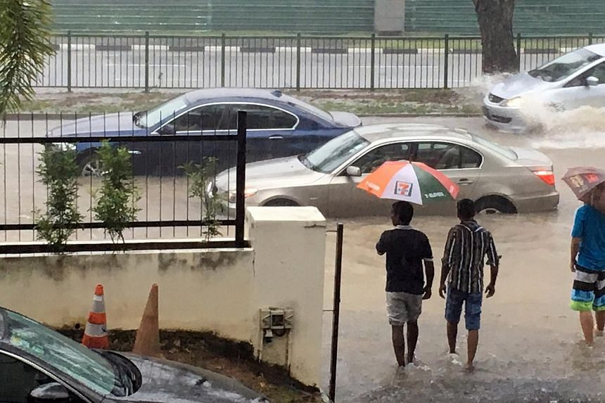Cars stranded in a flooded stretch of Yio Chu Kang Road on the afternoon of Dec 5, 2015, when heavy rain caused flash floods in several areas of Singapore.