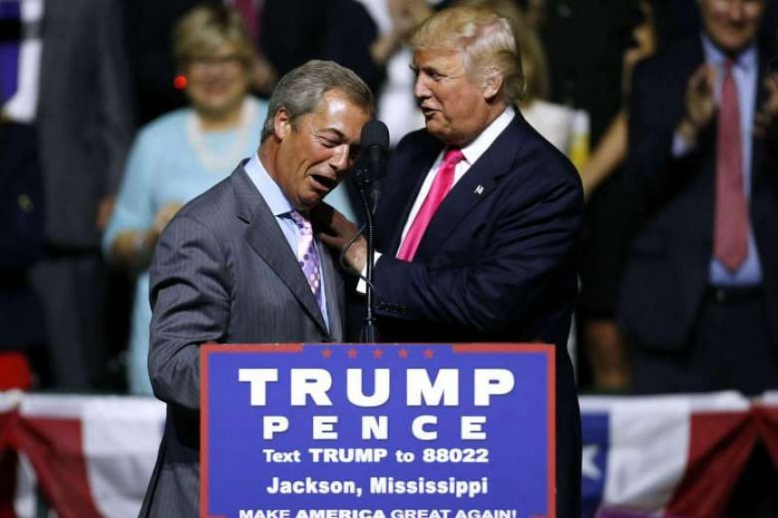 Republican Presidential nominee Donald Trump (right) greets United Kingdom Independence Party leader Nigel Farage at a campaign rally on Aug 24, 2016 in Jackson, Mississippi.