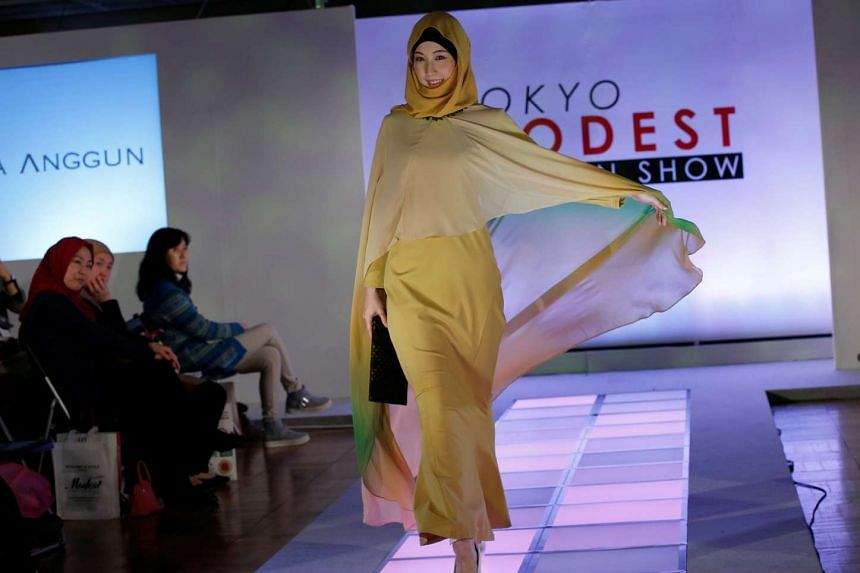 A model presents a creation by brand Alia Anggun during the Tokyo Modest Fashion Show at Halal Expo Japan in Tokyo on Nov 22, 2016.