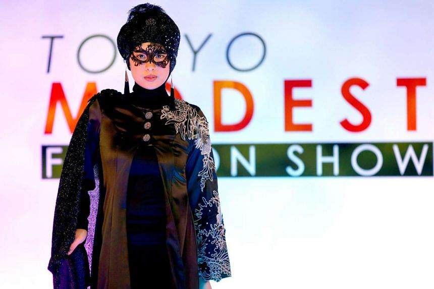 A model presents a creation by designer Lynn Siregar from her brand Weddingku Gallery during the Tokyo Modest Fashion Show at Halal Expo Japan in Tokyo on Nov 22, 2016.