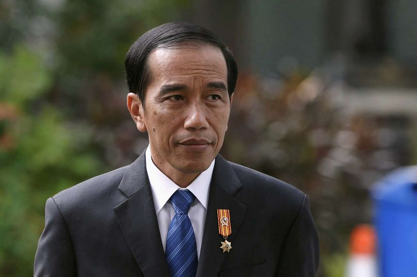 Indonesian President Joko Widodo called for calm after helicopters dropped leaflets over the capital, warning residents of possible violence during the upcoming rallies led by Islamists.