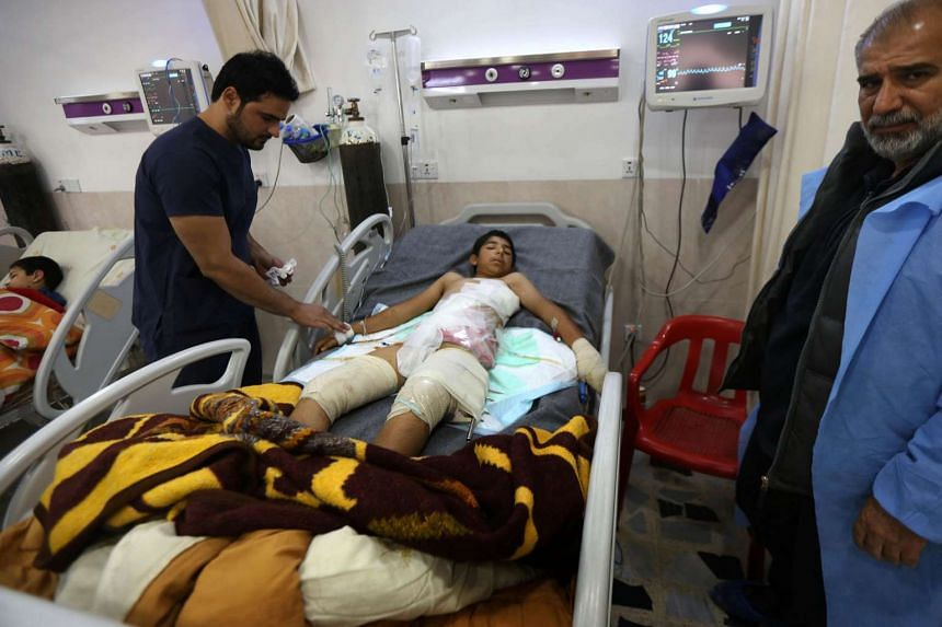 A wounded Iraqi youngster who was injured during the ongoing fighting between Iraqi forces and the Islamic State in Iraq and Syria receives medical treatment at a hospital in Arbil, the capital of Iraq's autonomous Kurdistan region, on Nov 24, 2016