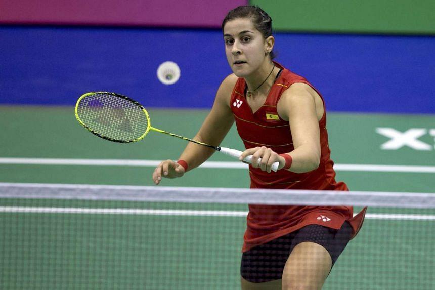Carolina Marin of Spain returns a shot to Yip Pui-yin of Hong Kong during the Yonex-Sunrise Hong Kong Open badminton tournament on Nov 24, 2016.