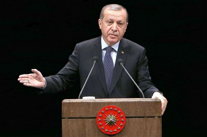 Turkish President Recep Tayyip Erdogan addresses a speech to teachers during a ceremony on Nov 24, 2016 marking Teachers' Day, at Bestepe People's Congress and Culture Center in the Presidential Complex in Ankara.