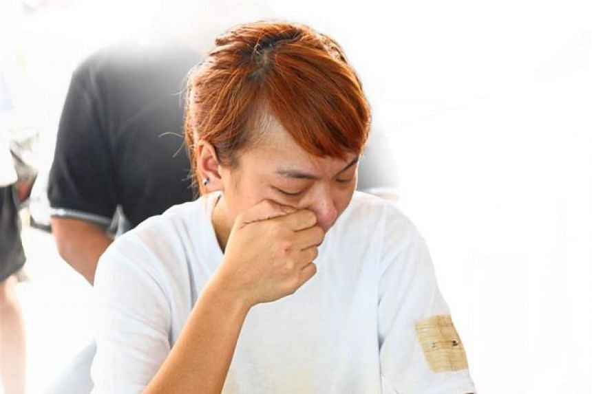 Mr Fong Meng Tuck's daughter weeping at the wake in Maccallum Street, Penang.