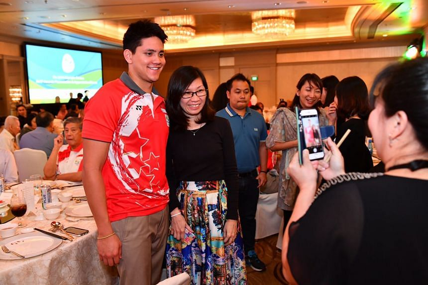 Swimmer Joseph Schooling poses for a photo with Madam Basia Teh on Thursday (Nov 24).