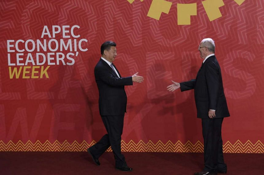 Chinese President Xi (left) meeting his Peruvian counterpart, Mr Pedro Pablo Kuczynski, at the Apec Summit in Lima last week. In view of President-elect Trump's vow to pull the US out of the TPP, Mr Xi has wasted no time in presenting his country as a rel