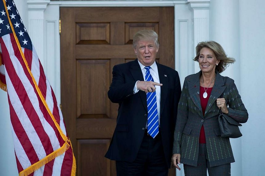 President-elect Donald Trump and Betsy DeVos after their meeting at Trump International Golf Club, in Bedminster Township, New Jersey on Nov 18, 2016.