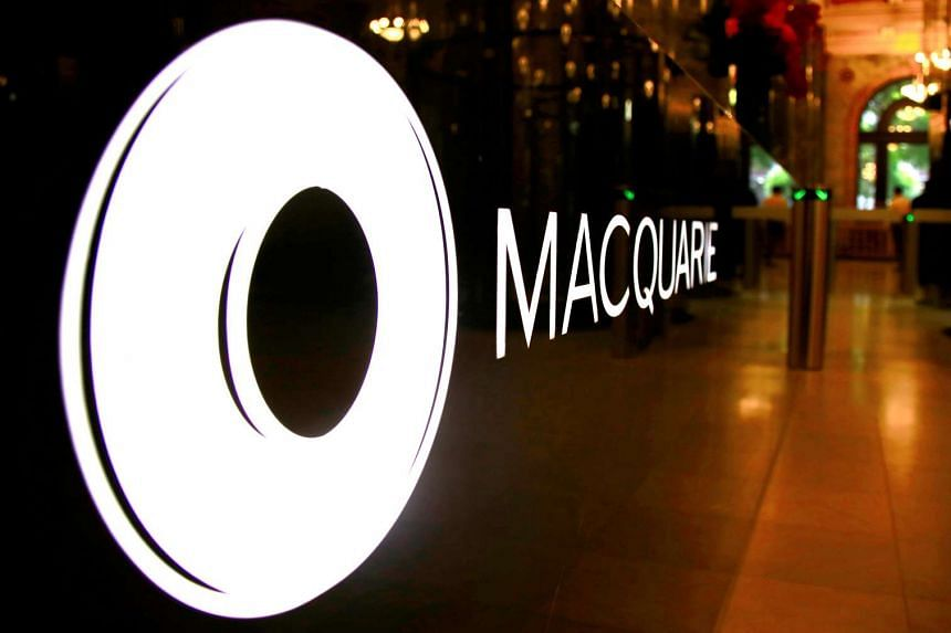 The logo of Australia's biggest investment bank Macquarie Group adorns a desk in the reception area of their Sydney office headquarters in Australia, on Oct 28, 2016.