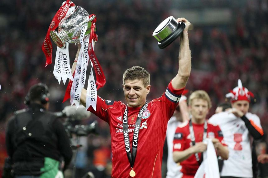 Liverpool's Steven Gerrard celebrates with the trophy after winning the Carling Cup Final.