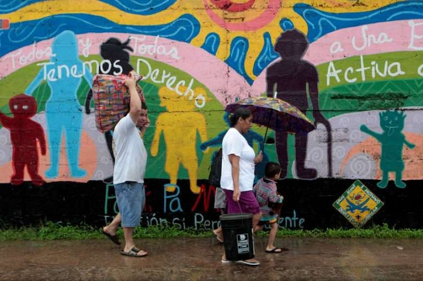 People walk during the evacuation to shelters prior to the arrival of hurricane Otto in Bluefields, Nicaragua Nov 24, 2016.