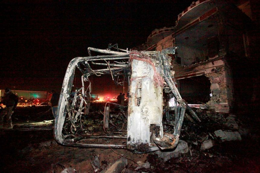 Destroyed vehicles are seen at the site of a suicide truck bomb attack, at a petrol station in the city of Hilla south of Baghdad, Iraq, Nov 24, 2016
