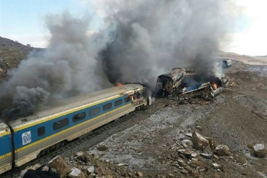 A handout picture shows the damaged trains following the accident in Semnan province, some 250kms east of the Iranian capital Teheran.