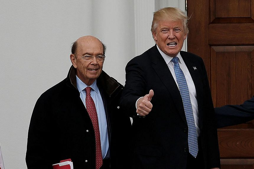 Mr Ross, seen here with the President-elect at the Trump National Golf Club in Bedminster, New Jersey, on Sunday, worked closely on crafting Mr Trump's tax-reduction and infrastructure spending agenda.