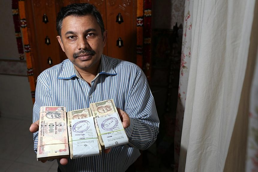 Mr Balu, who bought $4,000 worth of rupees from a bank in Bangalore in August, has to return to India to exchange them for new ones by the end of March. Since India's move to invalidate its 500 and 1,000 rupee bills earlier this month, money changers