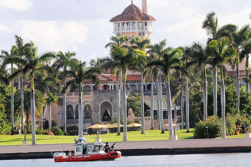 A US Coast Guard boat passing the Mar-a-Lago Resort in Palm Beach where Mr Trump spent Thanksgiving on Wednesday. The President-elect plans to further relax funding rules for the inauguration festivities.