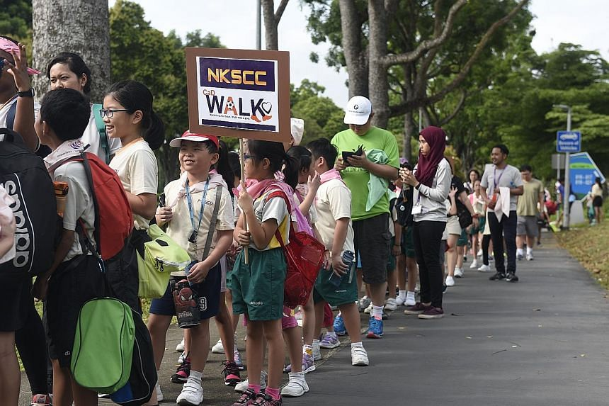 About 550 pupils, parents and teachers took part in a 3km charity walk yesterday that raised $7,000 for the Cerebral Palsy Alliance Singapore. The primary school pupils were from 12 student care centres operated by private education company Mercu Lea