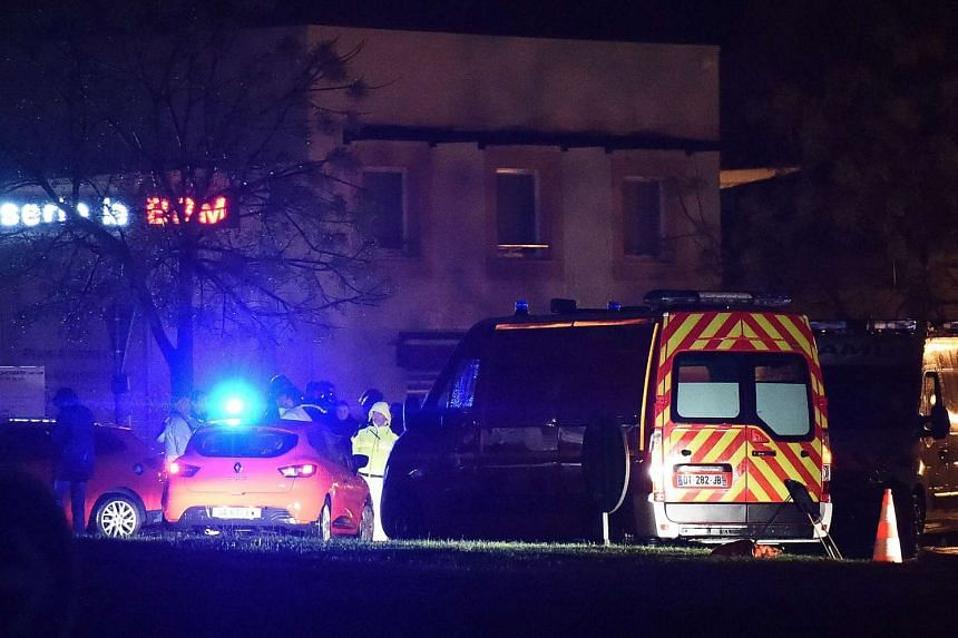 Rescue members stand guard along a security area near a retirement home for Catholic missionaries in Montferrier-sur-lez, near Montpellier, Southern France, on Nov 25, 2016.