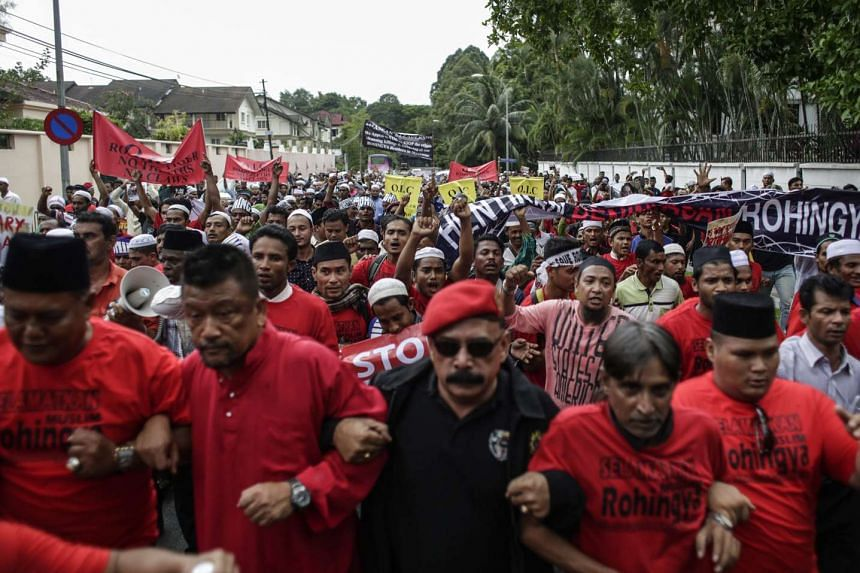 Malaysia activists and Myanmar ethnic Rohingya Muslims march during a protest in front of the Myanmar Embassy in Kuala Lumpur, Malaysia on Nov 25, 2016.