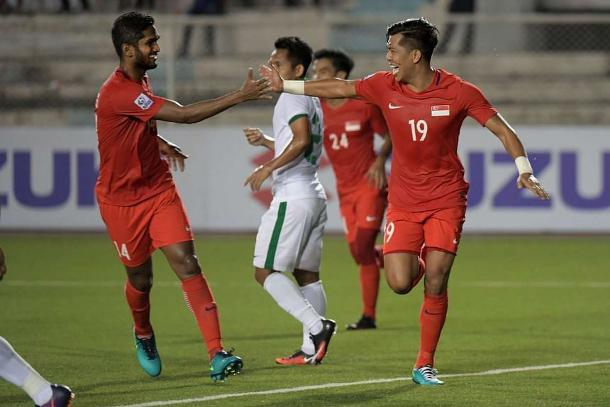 Khairul Amri celebrates is goal in first half with Hariss Harun (left) during the Suzuki Cup match against Indonesia in Manila on Nov 25, 2016.