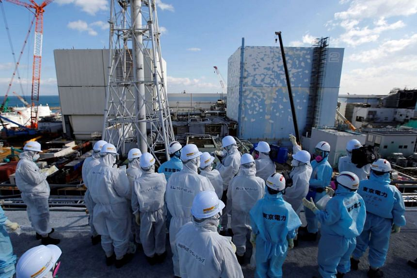 Members of the media, wearing protective suits and masks, undergo a briefing at Japan's tsunami-crippled Fukushima Daiichi nuclear power plant on Feb 10,2016. South Africa's Thyspunt plant could be at risk of similar devastation to Fukushima, say exp