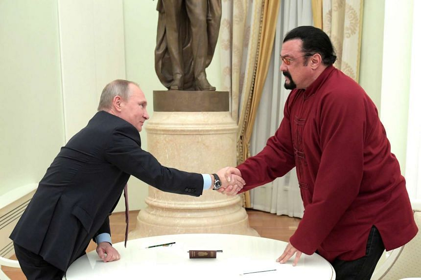Putin (left) shakes hands with Seagal during a meeting at the Kremlin in Moscow, Russia, Nov 25, 2016.
