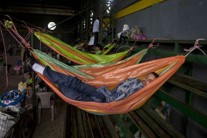 People sleep in a community shelter after Hurricane Otto hit Cardenas, Nicaragua, Nov 25, 2016.