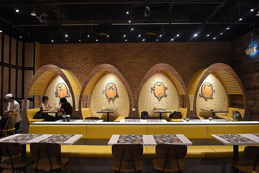 Gudetama Cafe features egg-shaped booths and chairs in the main dining area.