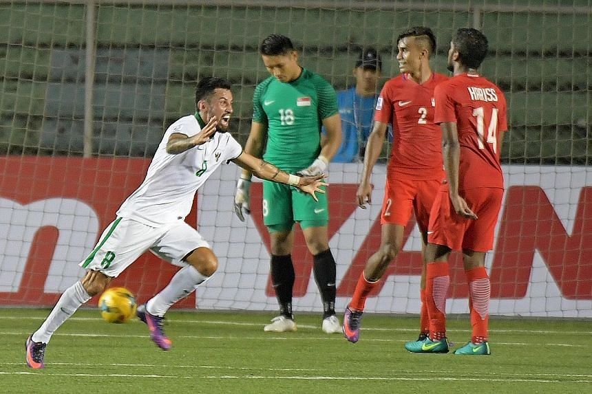 Stefano Lilipaly celebrating his goal which turned out to be the winner against Singapore in their Suzuki Cup match last night. The disappointment on the faces of Lions goalkeeper Hassan Sunny, defender Shakir Hamzah and midfielder Hariss Harun is te