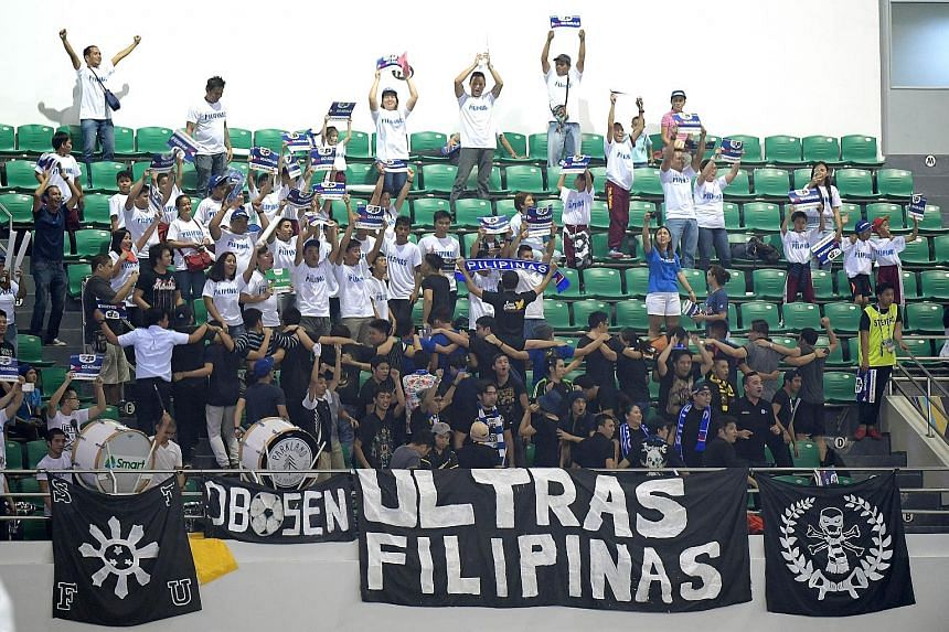 Above: A section of the Filipino die-hard football fans enjoying themselves at the 2-2 draw against Indonesia on Tuesday night at the Philippine Sports Stadium in Bocaue. Left: The stadium (right) in the province of Bulacan, about 35km north of Metro