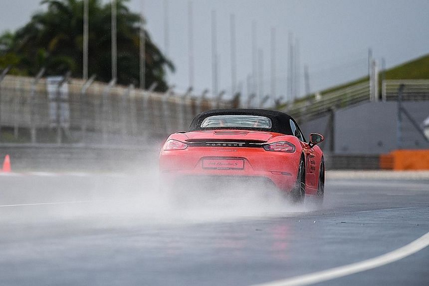 A 911 Carrera 4S (above) demonstrated the dynamics of rear-engined cars, while a 718 Boxster S (left) revealed the differences of a mid-engined car.